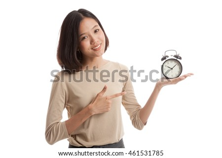 Young Asian business woman point to a clock  isolated on white background .