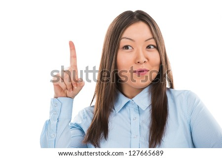 Young asian business woman pointing up and having good idea - stock photo