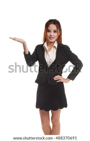 Young Asian business woman present with her hand  isolated on white background.