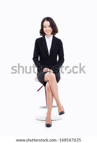 Young Asian business woman sitting on the chair isolated on white background.  - stock photo