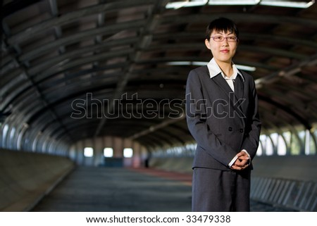 Young asian business woman standing pose with confident