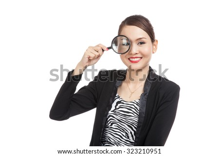 Young Asian business woman with a magnifying glass  isolated on white background