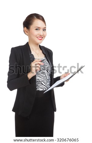 Young Asian business woman with pen and clipboard  isolated on white background