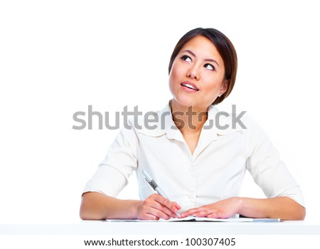 Young asian business woman writing. Isolated on white background. - stock photo