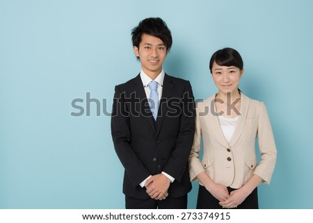 young asian businessman and businesswoman