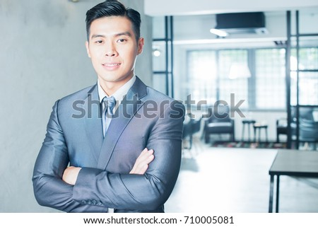 Young Asian businessman. Image with lens flare effect.