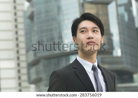 Young Asian businessman portrait in Hong Kong central district with copyspace. - stock photo