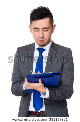 Young Asian Businessman take note on clipboard