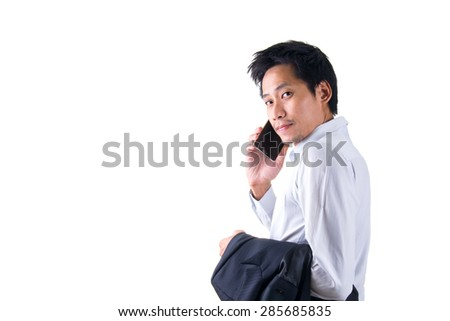 Young Asian Businessman Talking On Mobile Phone - stock photo