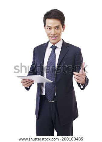 young asian businessman with tablet computer, isolated on white. - stock photo