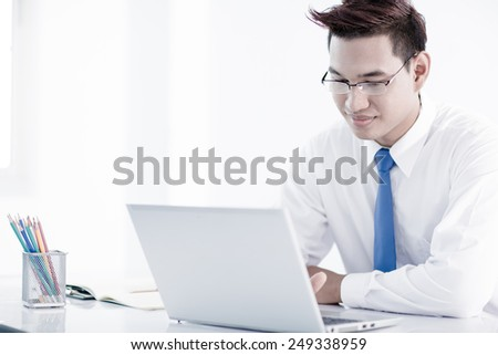 young asian businessman working in office - stock photo