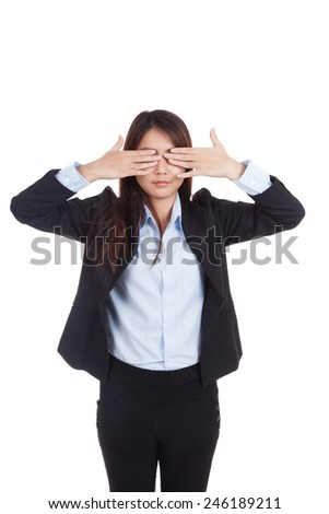 Young Asian businesswoman close her eyes with both  hands  isolated on white background