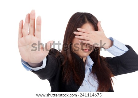 Young Asian businesswoman cover her eye say no  isolated on white background