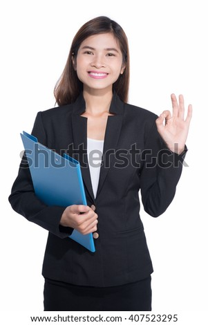 Young asian businesswoman hold with folder and showing ok sign isolated on white background. - stock photo