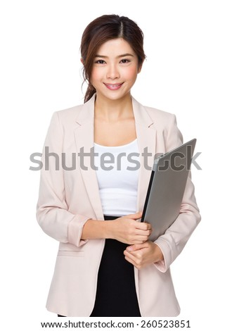 Young asian businesswoman hold with laptop computer - stock photo