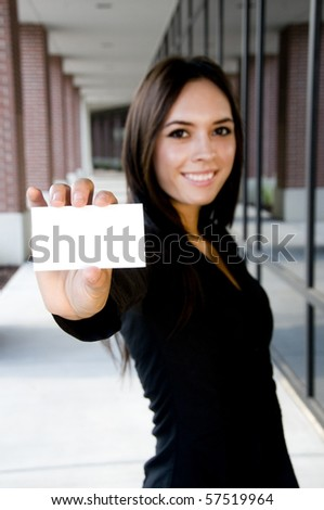 Young asian businesswoman holding a blank card