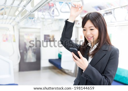 young asian businesswoman in the train - stock photo