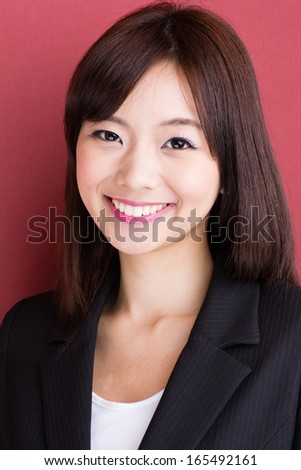 young asian businesswoman on red background
