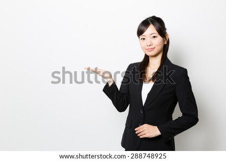 young asian businesswoman on white background - stock photo