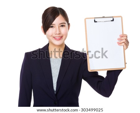 Young asian Businesswoman showing white paper on board - stock photo