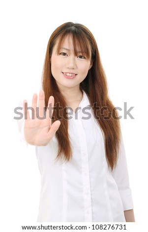 Young asian businesswoman smiling and showing her hand - stock photo
