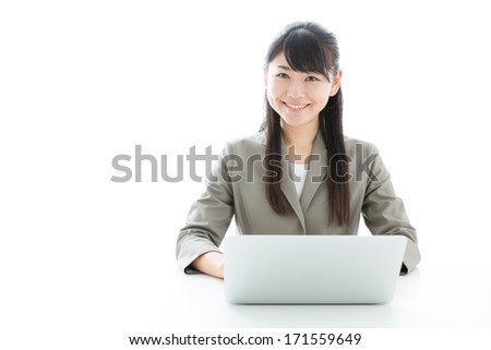 young asian businesswoman using laptop computer on white background