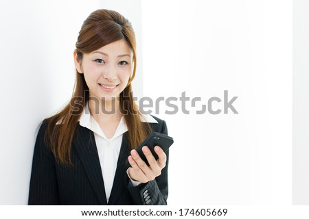 young asian businesswoman using smart phone