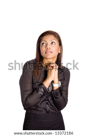 Young Asian businesswoman with both hands clasp together, hoping and praying. - stock photo