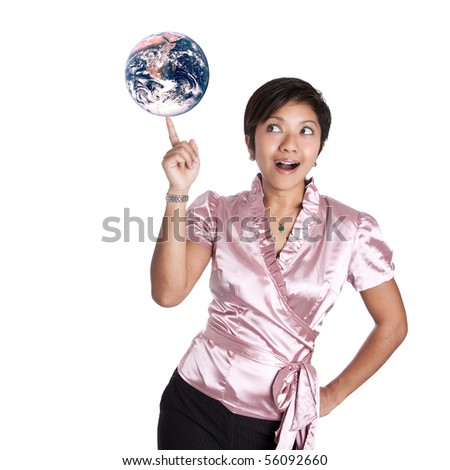 Young Asian businesswoman with the world balancing in hand
