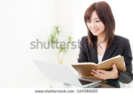 young asian businesswoman working in the office - stock photo