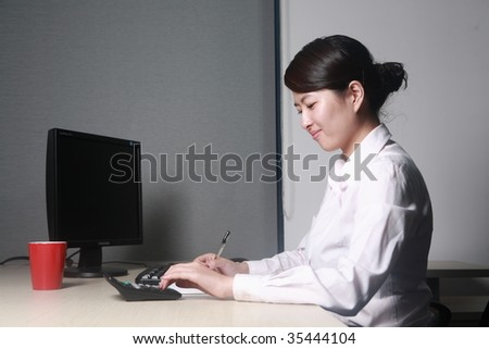 young asian businesswoman working with computer in office