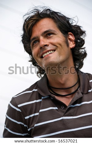 Young asian-caucasian man smiling and being happy - stock photo