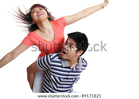 Young asian cheerful couple isolated in white background