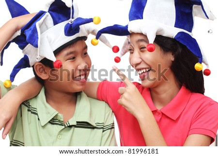 Young asian children wearing a clown hat - stock photo