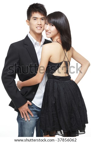 Young, asian, chinese couple on a romantic date. Smart casual dress and jacket. Intimate pose. - stock photo