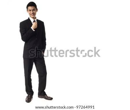 Young Asian Corporate Man adjusting tie over white background