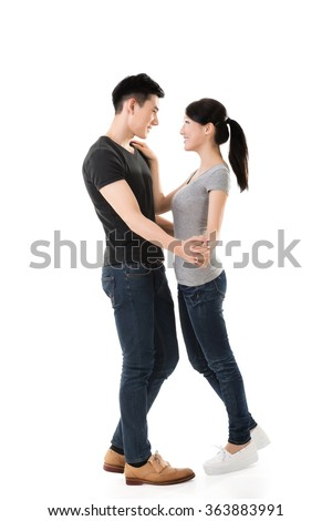 young Asian couple dancing with smiling face. - stock photo