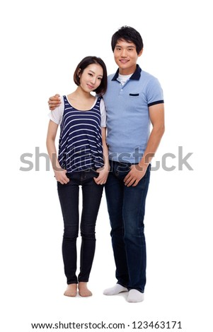 Young Asian couple full shot isolated on white background.