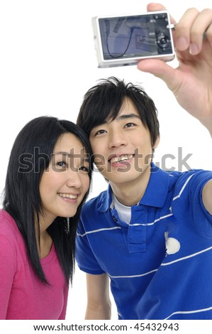 Young asian couple taking a photo of themselves - stock photo