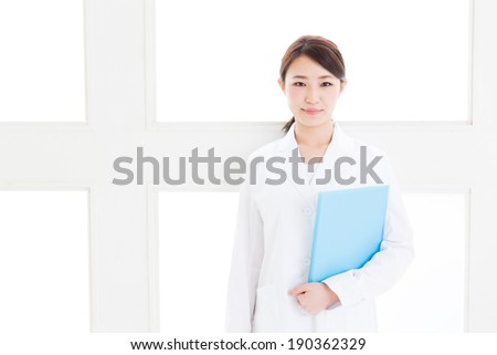 young asian doctor in the hospital - stock photo