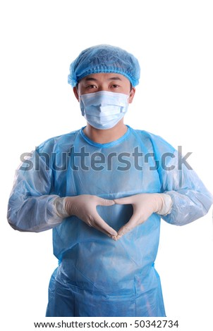 Young Asian doctor with heart shape gesture - stock photo