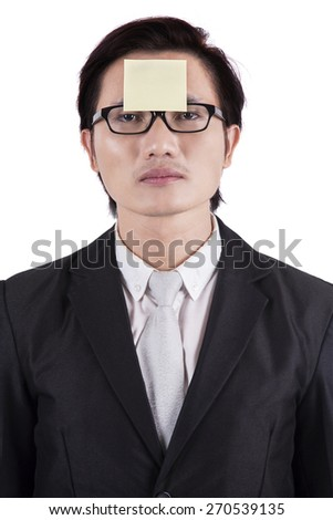 Young asian entrepreneur attached a blank paper notes on his forehead, isolated on white - stock photo
