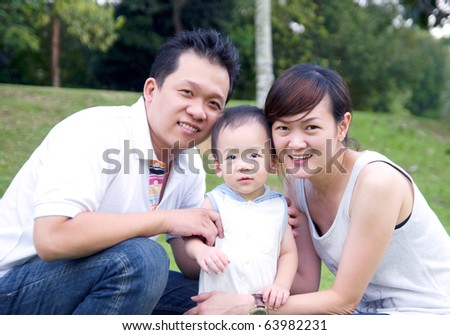 young asian family - stock photo