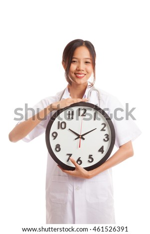 Young Asian female doctor happy show a clock  isolated on white background .