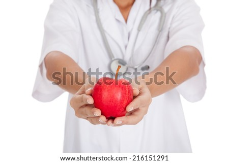 Young Asian female doctor show an apple  isolated on white background