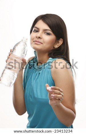 young Asian  female drinking water from a bottle - stock photo