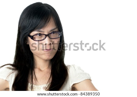 young asian female looking angry wearing black glasses - stock photo
