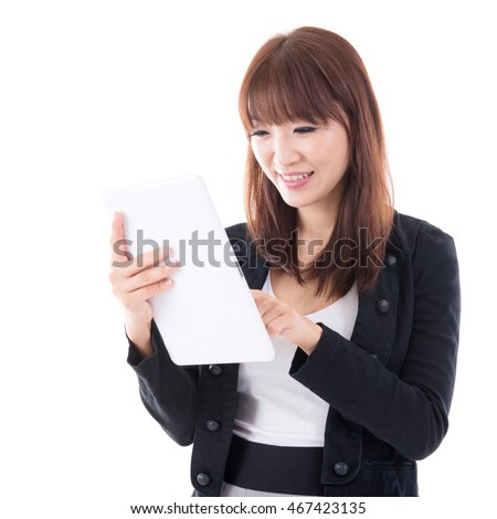 Young Asian female using digital computer tablet, isolated on white background.