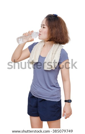 Young Asian girl drinking water from bottle over white