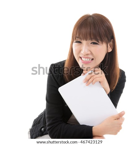 Young Asian girl holding digital computer tablet and smiling, isolated on white background.